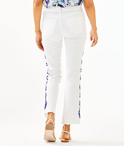 27.5 South Ocean Crop Flare Jean in white lapis geo border