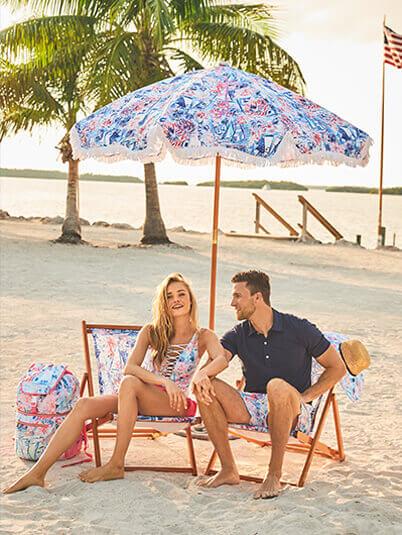 Couple under beach umbrella