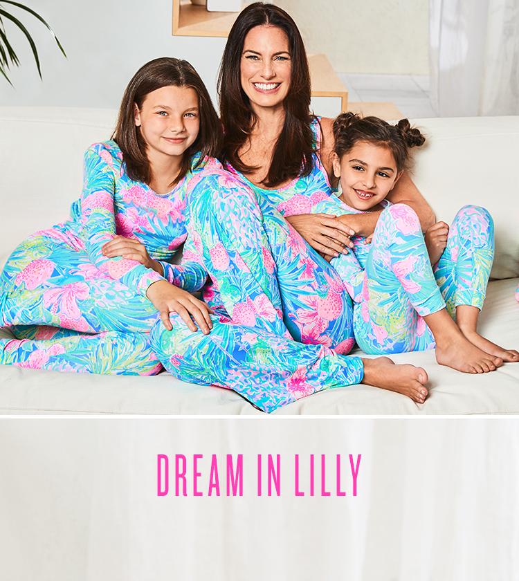 Woman And Girls Sitting Wearing Lilly Pulitzer Matching Printed Pajamas Next to Lilly Pulitzer Printed Fleece Blanket